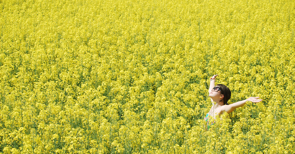 Girl standing in a field of flowers